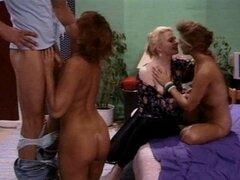 Three fit ladies are desperate for his dick in a sexy retro scene