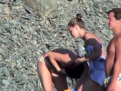 Beach voyeur captures a cute brunette teen with perky boobs