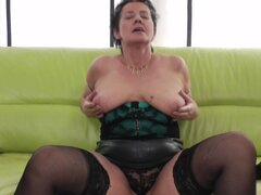 Superb Moans as matured granny in stockings fingers her pussy - Ivetta