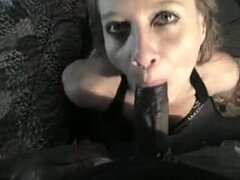 Sexy Wench Golden-Haired Cougar Getting Down on Knees to Suck BBC, Sexy floozy white golden-haired cougar getting down on her knees to suck bbc.