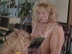 Nina Hartley is having fun with a lady in the office - Nina Hartley