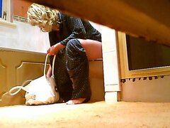 Blonde fem caught on spy cam pissing on toilet with phone, A blonde female has come to the wc room and sat on the bowl. She never stops pressing the buttons of her mobile phone even when pissing on toilet. The spy cam has shot everything