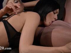 Horny brunette sucking cock of rubber